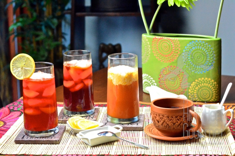 From left to right: 1) Cha Ma Naw, Sweeten ice tea with lime or lemon (#4 on list) 2) Cha Dam Yen, Sweetened ice tea (#3 on list) 3) Cha Yen, Sweetened ice tea with sweet condensed milk (#1 on list) and in this picture topped with cream. 4) Cha Ron, sweetened tea with sweet condensed milk (#2 on list)